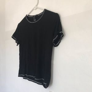 Plain black top with white threads